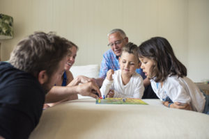 family playing board game_for web